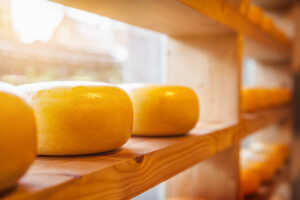 Cheeses on a wooden shelf