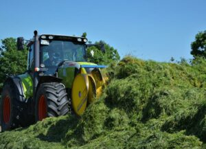 Tractor working with forage